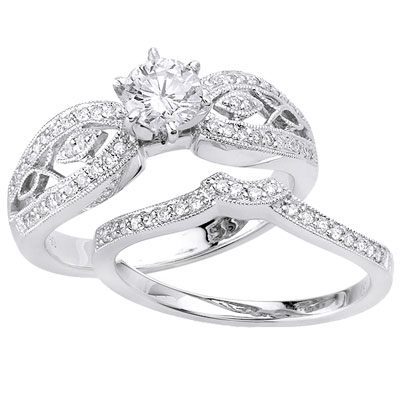 The engagement ring features a round center diamond (0.50 ctw) at the middle